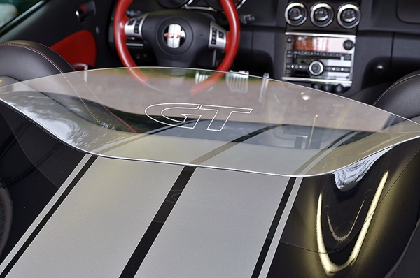 "Removeable wind deflector clear with outline ""GT"" logo"